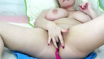 lovely blonde babe having fun with lush toy above webcam