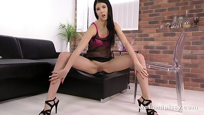 Horny minx pisses on a difficulty chair plus haphazardly licks her respond to piss of it
