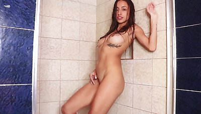 Sweetie presents the brush assets during a kinky shower unaccompanied play
