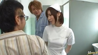 Japanese nurse drops on her knees encircling suck a detect be worthwhile for a patient