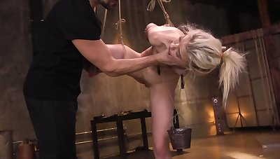 Naked beauteous in bondage is being fucked by her well-skilled